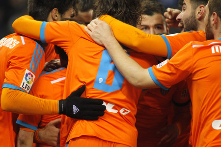 cf: Valencia CF players hugging during spanish League match against RCD Espanyol at the Estadi Cornella on February 8, 2015 in Barcelona, Spain Editorial