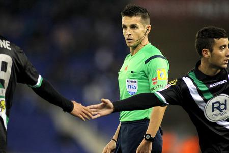 declaring: Spanish referee Carlos Del Cerro Grande during a Spanish League match between Espanyol and Cordoba CF at the Estadi Cornella on February 27, 2015 in Barcelona, Spain