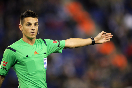 declaring: Spanish referee Carlos Del Cerro Grande during a Spanish League match between Espanyol and Cordoba CF at the Estadi Cornella on February 27, 2015 in Barcelona, Spain