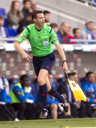 linesman: Spanish assistant referee Raul Cabanero during a Spanish League match at the Power8 Stadium on April 12 2015 in Barcelona Spain Editorial