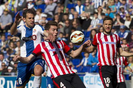 futbol: Christian Stuani of RCD Espanyol(L) and Aymeric Laporte(R) of Athletic de Bilbao during a Spanish League match at the Power8 Stadium on April 12 2015 in Barcelona Spain Editorial
