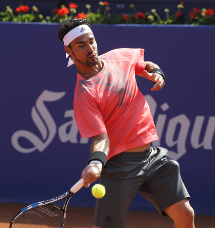 right handed: Italian tennis player Fabio Fognini in action during a match of Barcelona tennis tournament Conde de Godo on April 23 2015 in Barcelona Editorial