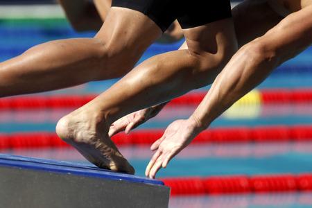 swimmer: Male swimmer starting swim event