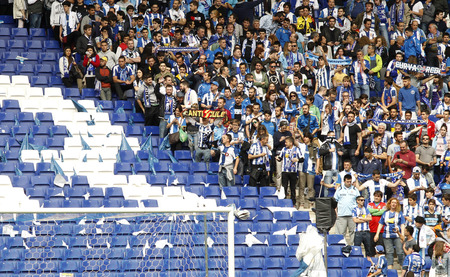 futbol: Group of supporters of Espanyol leave empty seats during a Spanish League match against FC Barcelona at the Estadi Cornella on April 25, 2015 in Barcelona, Spain Editorial