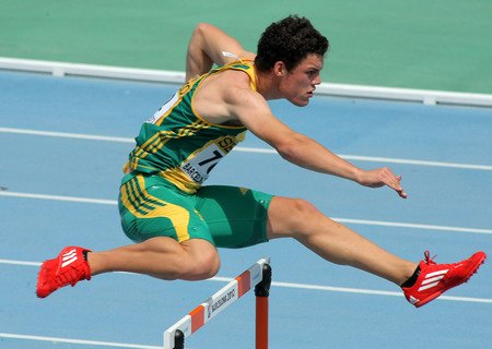 finalist: Bernardus Pretorius of South Africa during  400m hurdles event of the 20th World Junior Athletics Championships at the Olympic Stadium on July 11, 2012 in Barcelona, Spain