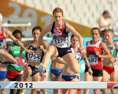 steeplechase: Pippa Woolven of Great Britain in action on 3000 meters Steeplechase of the 20th World Junior Athletics Championships at the Olympic Stadium on July 10, 2012 in Barcelona, Spain Editorial