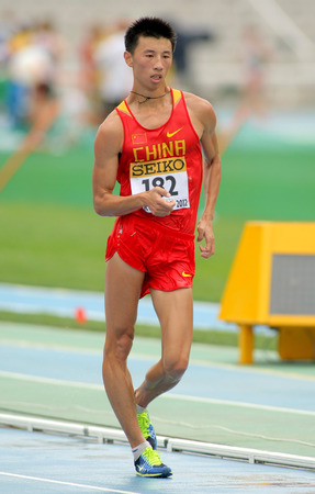 metres: Guanyu Su of China during 10000 metres race walk event of of the 20th World Junior Athletics Championships at the Olympic Stadium on July 13, 2012 in Barcelona, Spain
