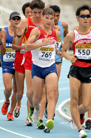 metres: Aleksandr Ivanov of Russia during 10000 metres race walk event of of the 20th World Junior Athletics Championships at the Olympic Stadium on July 13, 2012 in Barcelona, Spain