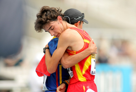 metres: Alvaro Martin of Spain and Eider Arevalo of Colombia embraces when finished 10000 metres race walk event of of the 20th World Junior Athletics Championships at the Olympic Stadium on July 13, 2012 in Barcelona, Spain
