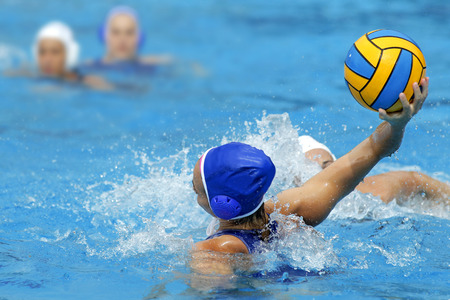 Two waterpolo players in action during a match