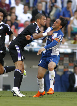 winger: Pepe of Real Madrid fight with Sergio Garcia Espanyol fight during a Spanish League match against RCD Espanyol at the Power8 stadium on Maig 17 2015 in Barcelona Spain