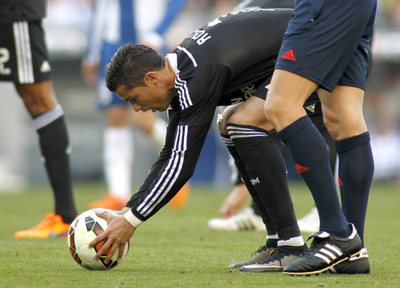 kick off: Cristiano Ronaldo of Real Madrid preparing to launch kick off  during a Spanish League match against RCD Espanyol at the Power8 stadium on Maig 17 2015 in Barcelona Spain