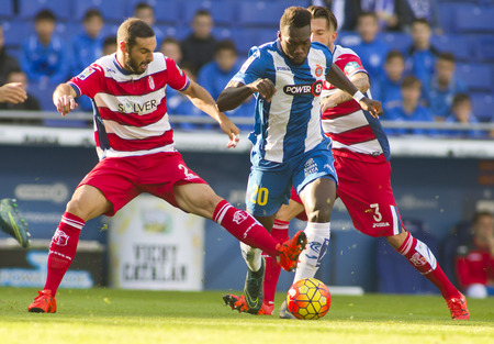 cf: David LombanL of Granada CF and Felipe CaicedoR of RCD Espanyol fight during a Spanish League match at the Power8 stadium on November 1 2015 in Barcelona Spain