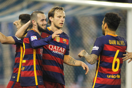 futbol: FC Barcelona players Aleix Vidal, Rakitic and Alves celebrating goal during a Spanish Cup match against RCD Espanyol at the Power8 stadium on January 13, 2016 in Barcelona, Spain
