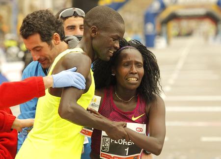 world record: Florence KiplagatR with Abel KiruiL after to break half Marathon world record during Barcelona Half Marathon in Barcelona on February 15, 2015 in Barcelona, Spain.