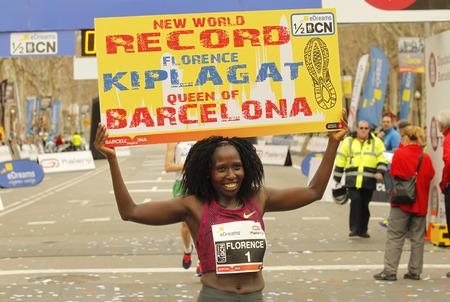 world record: Florence Kiplagat after to break half Marathon world record during Barcelona Half Marathon in Barcelona on February 15, 2015 in Barcelona, Spain. Editorial