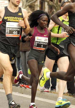 world record: World record woman Florence Kiplagat in Barcelona streets running during Barcelona Half Marathon in Barcelona on February 15, 2015 in Barcelona, Spain.