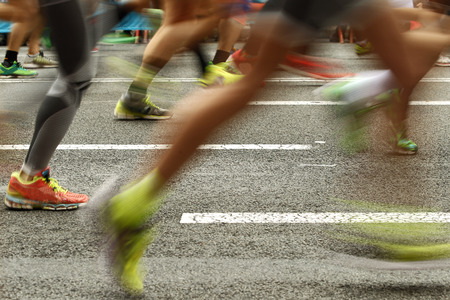 Runners feet on the road in blur motion during a long distance running event Standard-Bild