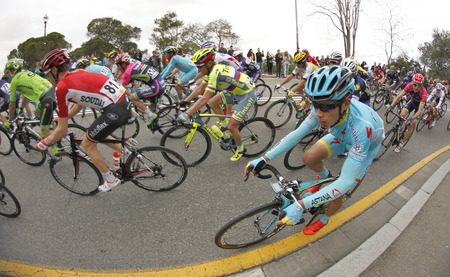 rides: Miguel Angel Lopez of Astana Team rides with the pack during the Tour of Catalonia cycling race through the streets of Monjuich mountain in Barcelona on March 27, 2016 Editorial