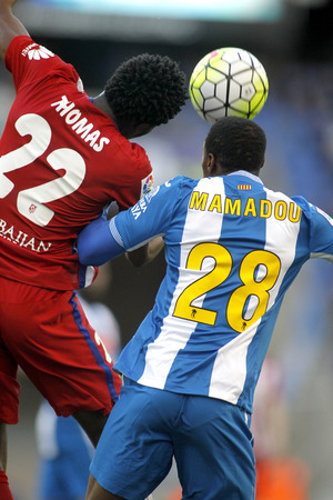 Thomas Partey(L) of Atletico Madrid and Mamadou Sylla(R) of RCD Espanyol vie during a Spanish League match at the Power8 stadium on April 9, 2016 in Barcelona, Spain