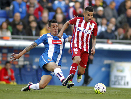 enzo: Enzo Roco(L) of RCD Espanyol and Angel Correa(R) of Atletico Madrid during a Spanish League match at the Power8 stadium on April 9, 2016 in Barcelona, Spain