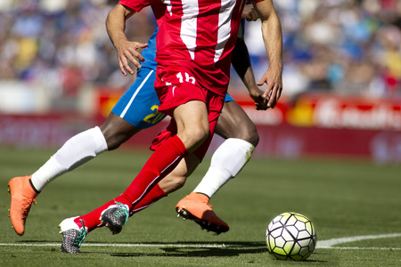 Legs of two soccer players vie on a match Standard-Bild