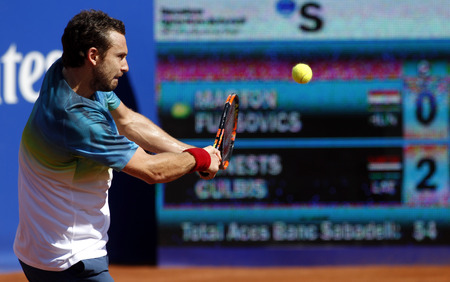 atp: Latvian tennis player Ernests Gulbis in action during a match of Barcelona tennis tournament Conde de Godo on April 19, 2016 in Barcelona