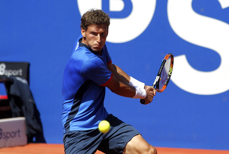 pablo: Spanish tennis player Pablo Carreno Busta in action during a match of Barcelona tennis tournament Conde de Godo on April 19, 2016 in Barcelona Editorial
