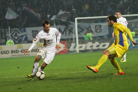 inter: RIJEKA, CROATIA - NOV, 24: soccer match between HNK Rijeka (white) vs. HNK Inter (yellow) on Novemeber 24, 2012 in Rijeka, Croatia Editorial