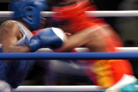 jab: Generic boxers throwing punches during a boxing match in a ring.