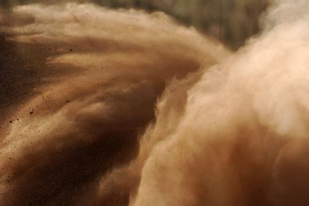 fills: A motorsport rally dust cloud fills the space. Stock Photo