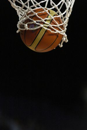 but: A basketball sees nothing but net as it drops through the ring.