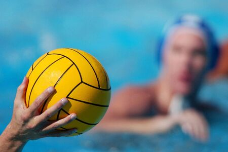 waterpolo: A waterpolo ball and player.