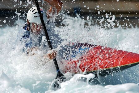 kayaker: A kayaker races through the rappids. Stock Photo