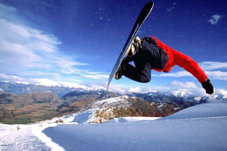 coronet: A snowboarder does a inveted trick at the half pipe at Coronet Peak, New Zealand.