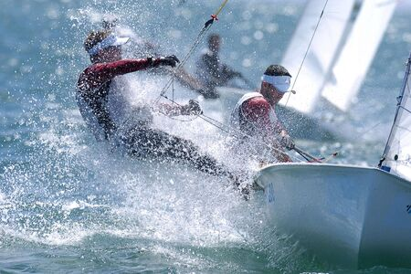 the seas: Sailors are splashed by the rough seas while sailing. Stock Photo