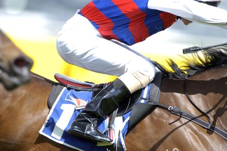 A close up of a jockey riding on a horse during a race Stock Photo - 777719