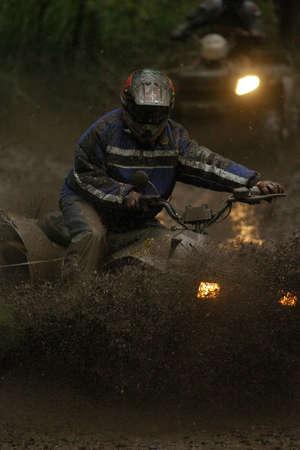motorsports: Two Quad bike racers (ATV) blast through a muddy hole