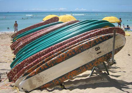 rentals: Surfboard rentals sit on Waikiki Beach, Honolulu, Hawaii. Stock Photo