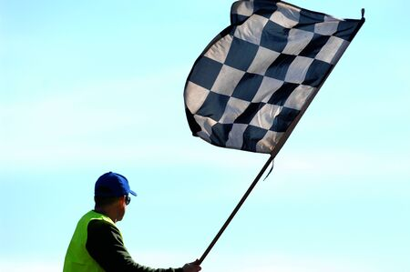 waved: A checkered flag being waved at the completion of a race.
