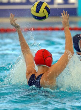 misses: A female water polo goalie misses a shot