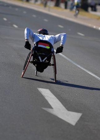 disabled sports: Single wheelchair athlete in action during a marathon.  Stock Photo