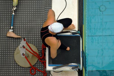 disabled person: A multi disability swimmer waits for a race start Stock Photo