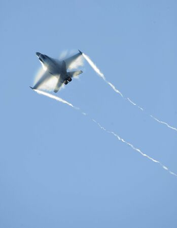airforce: An airforce jet fighter streaks through the sky.