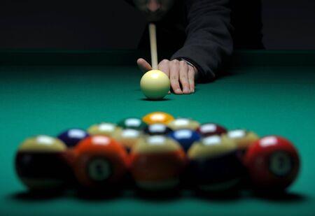 cue sticks: Balls on a pool (billard) table during play Stock Photo