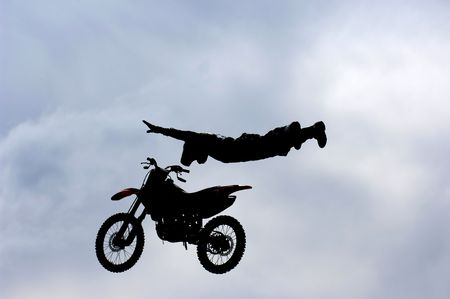 A freestyle motocross rider performs a trick (superman) during a competition. Stock Photo - 3579301