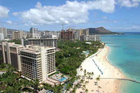 bathers: Looking out across Waikiki Beach to Diamond Head with sunbathers enjoying the sand and surf. Stock Photo