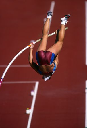 vaulting: A female pole vaulter in action