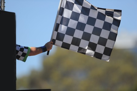 A chequered flag being waved on a raceway. Stock Photo - 7068022