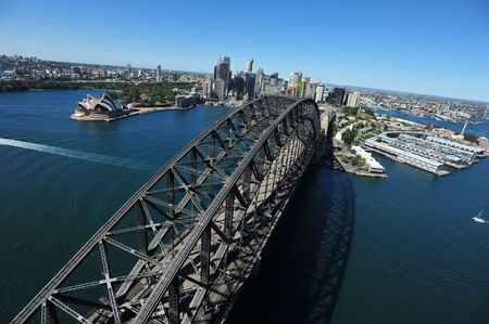 sydney harbour bridge: An aerial view of the Sydney Harbour Bridge as the sunlight shimmers on the water below. Stock Photo